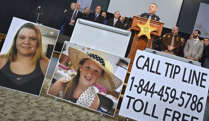 In this Feb. 22, 2017, file photo, Indiana State Police Peru post public information officer Tony Slocum provides the latest details of the investigation into the murders of teenage girls Liberty German, left, and Abigail Williams in Delphi, Ind. Indiana