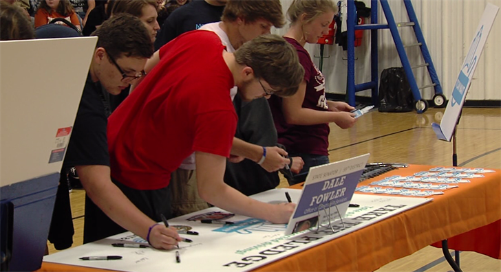 Students at Harrisburg High School sign a pledge to not text while drive.
