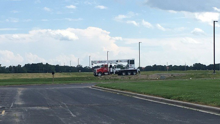 A crane is being brought in to flip plane back over.