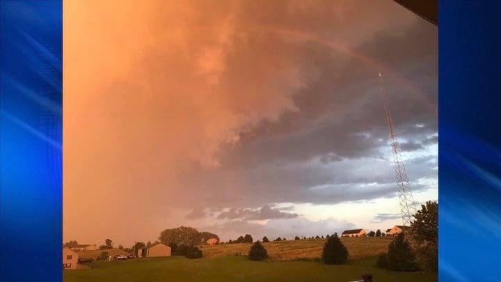 Rainbow over orange